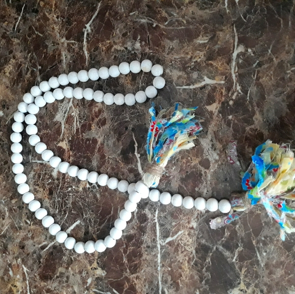 White decorative beads w/ tassel